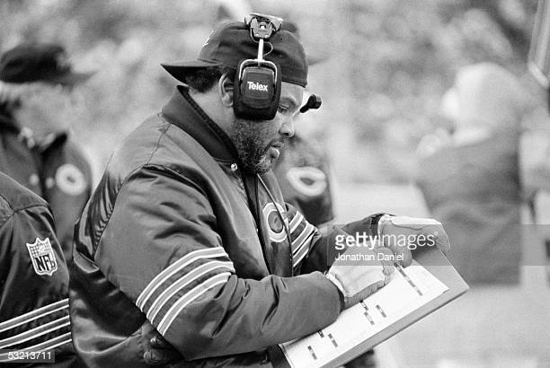 Assistant coach Johnny Roland of the Chicago Bears makes notes during the game against the Detroit Lions at Soldier Field on November 10 1985 in...
