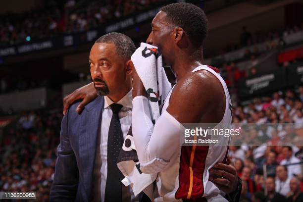 Assistant Coach Juwan Howard and Bam Adebayo of the Miami Heat speaks during the game against the Philadelphia 76ers on April 9 2019 at American...