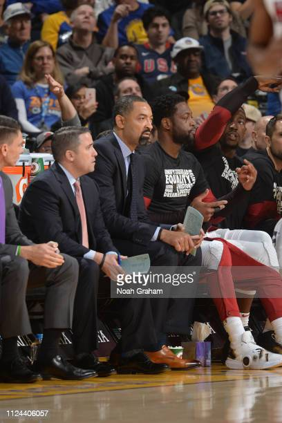 Assistant Coach Juwan Howard and Dwyane Wade of the Miami Heat look on during the game against the Golden State Warriors on February 10 at ORACLE...