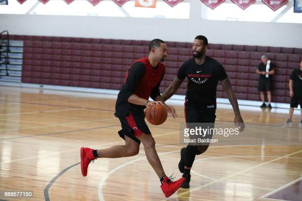 Assistant Coach Juwan Howard drives against James Johnson of the Miami Heat speaks to the media as part of the NBA Mexico Games 2017 on December 8...