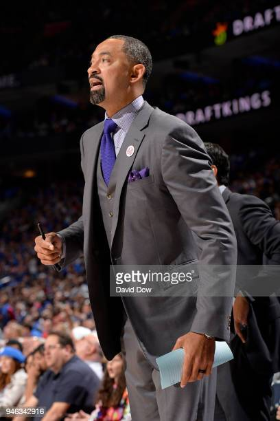 Assistant Coach Juwan Howard of the Miami Heat makes a call during the game against the Philadelphia 76ers in game one of round one of the 2018 NBA...
