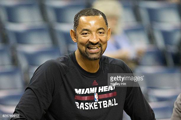 Assistant coach Juwan Howard of the Miami Heat smiles while watching the team warm up before a game against the Memphis Grizzlies at the FedExForum...