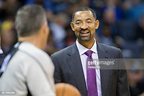 Assistant Coach Juwan Howard of the Miami Heat talks with a official during a game against the Memphis Grizzlies at the FedExForum on November 25...