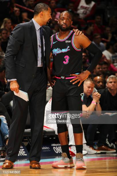 Assistant Coach Juwan Howard speaks with Dwyane Wade of the Miami Heat during the game against the Phoenix Suns on February 25 2019 at American...