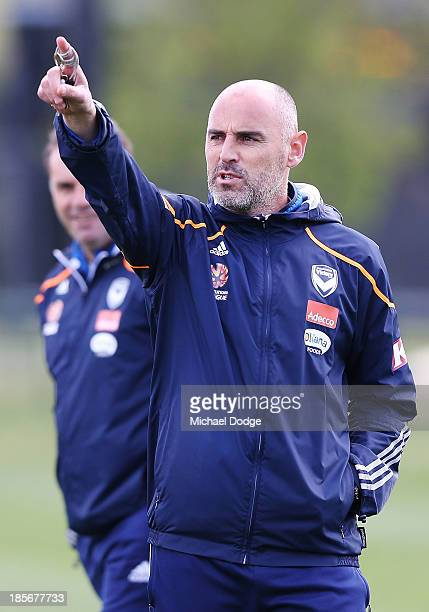 Assistant coach Kevin Muscat gestures in front of coach Ange Postecoglou during a Melbourne Victory ALeague training session at Gosch's Paddock on...