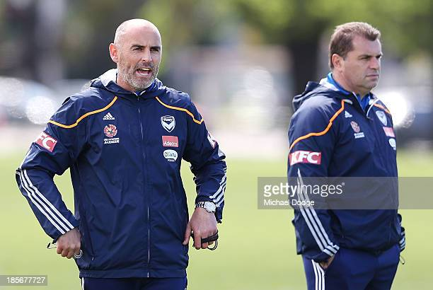 Assistant coach Kevin Muscat reacts next to coach Ange Postecoglou during a Melbourne Victory ALeague training session at Gosch's Paddock on October...