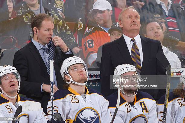 Assistant coach Kevyn Adams and head coach Lindy Ruff of the Buffalo Sabres watch the action during an NHL game against the Ottawa Senators at...