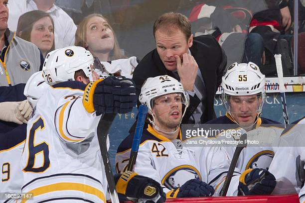 Assistant coach Kevyn Adams of the Buffalo Sabres talks with player Thomas Vanek of the Buffalo Sabres during an NHL game against the Ottawa Senators...