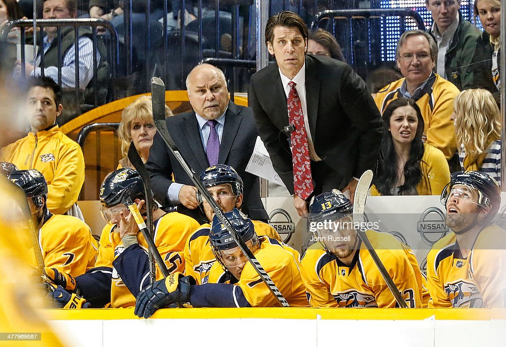 Assistant coach Lane Lambert and head coach Barry Trotz of the Nashville Predators watch the power play against the Columbus Blue Jackets at Bridgestone Arena on March 8, 2014 in Nashville, Tennessee.
