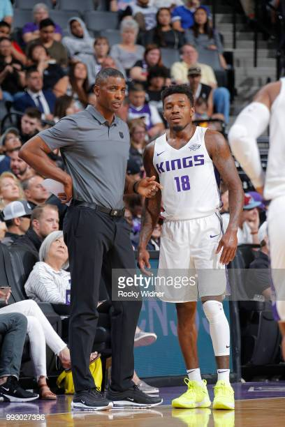 Assistant Coach Larry Lewis of the Sacramento Kings speaks with Daxter Miles Jr of the Sacramento Kings during the game against the Golden State...
