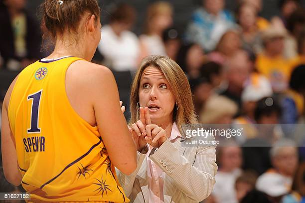Assistant Coach Laura Beeman talks to Sidney Spencer of the Los Angeles Sparks during the game against the Chicago Sky on June 18 2008 at Staples...