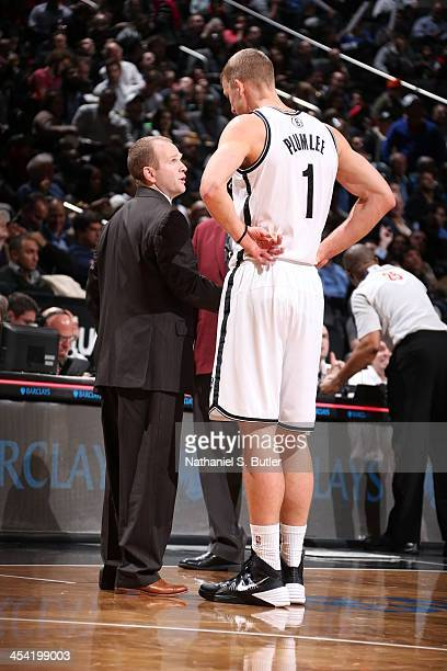 Assistant coach Lawrence Frank shares a word with Mason Plumlee of the Brooklyn Nets during the game against the Portland Trail Blazers at Barclays...
