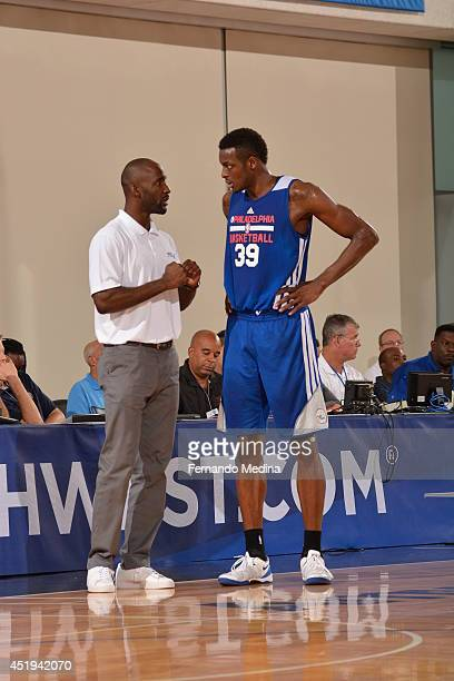 Assistant coach Lloyd Pierce of the Philadelphia 76ers speaks with Jerami Grant against the Brooklyn Nets during the Samsung NBA Summer League 2014...