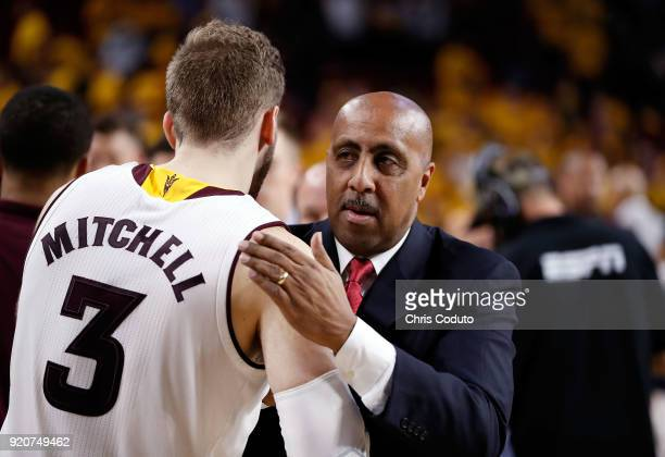 Assistant coach Lorenzo Romar of the Arizona Wildcats greets Mickey Mitchell of the Arizona State Sun Devils after the Wildcats beat the Sun Devils...