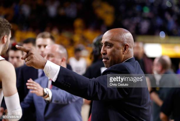 Assistant coach Lorenzo Romar of the Arizona Wildcats greets players after the Wildcats beat the Arizona State Sun Devils 7770 during the college...