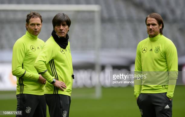 Assistant coach Marcus Sorg coach Joachim Loew and assistant coach Thomas Schneider of the German national soccer team during the final practice at...