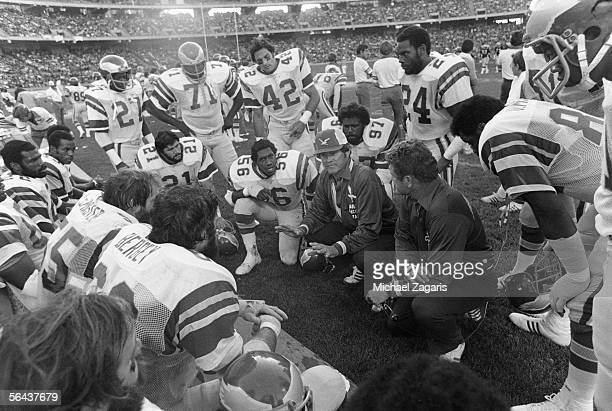 Assistant coach Marion Campbell of the Philadelphia Eagles talks to his players, including Jerry Robinson, John Sciarra, and Ken Clarke, during a...