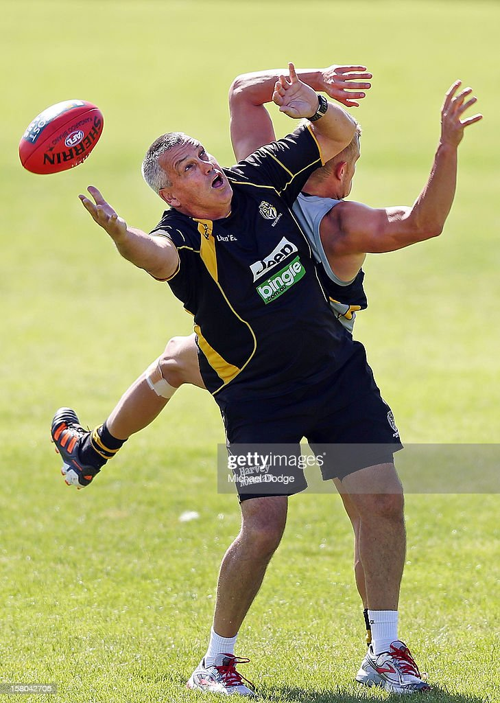 Assistant coach Mark Williams contests for the ball against Brandon Ellis during a Richmond Tigers AFL training session at Trevor Barker Beach Oval on December 10, 2012 in Melbourne, Australia.