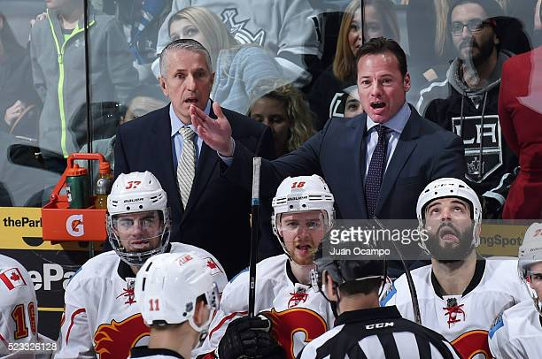 Assistant Coach Martin Gelinas and head coach Bob Hartley of the Calgary Flames argue a call with the referee during the game against the Los Angeles...