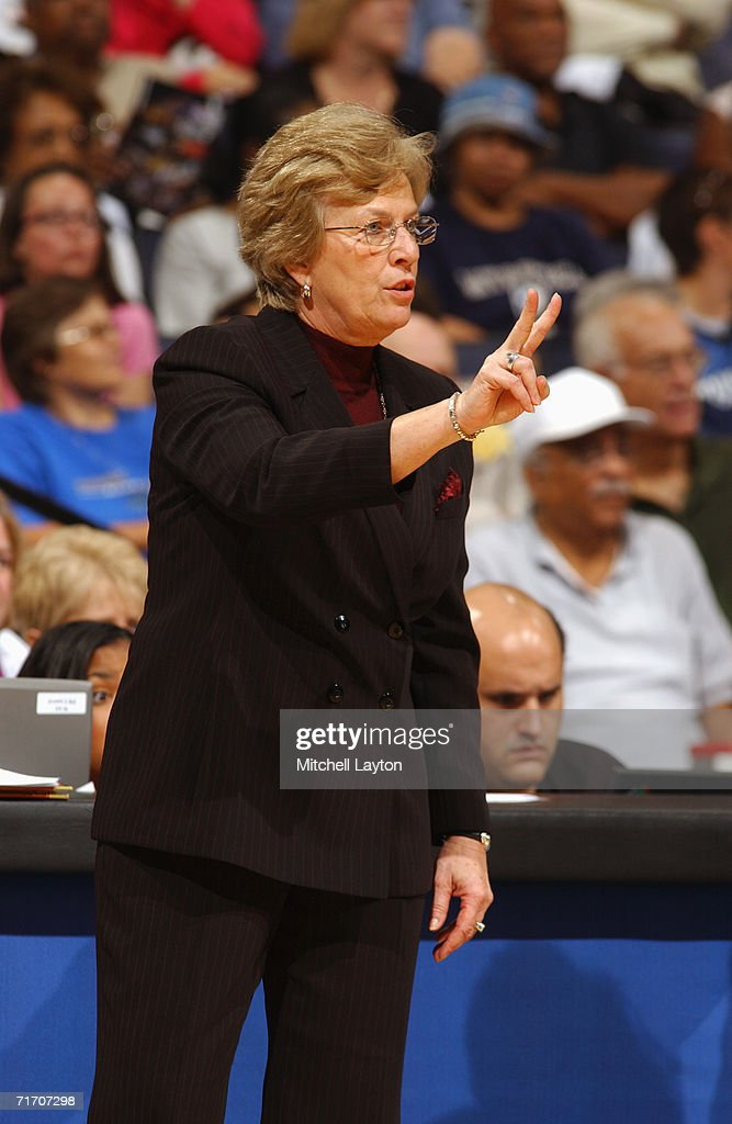 Assistant coach Marynell Meadors of the Washington Mystics signals a play from the sidelines during a game against the Detroit Shock at MCI Center on August 11, 2006 in Washington, D.C. The Mystics won 78-66.