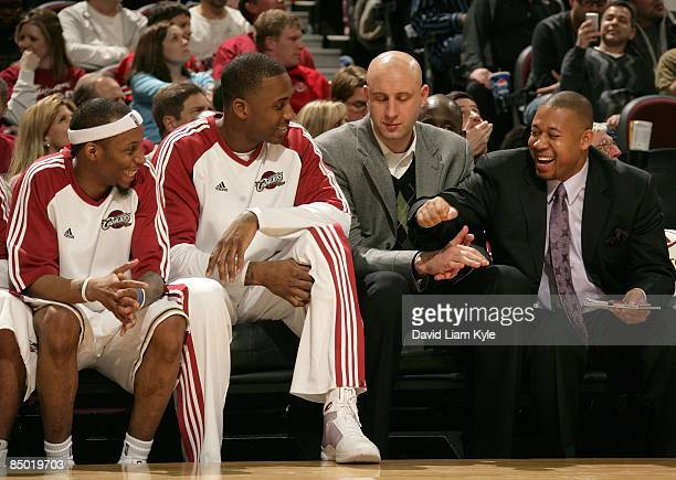 Assistant Coach Melvin Hunt of the Cleveland Cavaliers talks to his players Tarence Kinsey Lorenzen Wright and Zydrunas Ilgauskas during the game...
