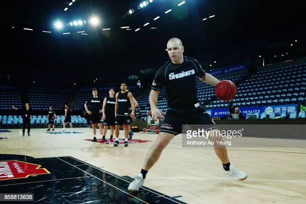 Assistant Coach Michael Fitchett of the Breakers runs warm up drills with the team prior to the round one NBL match between the New Zealand Breakers...