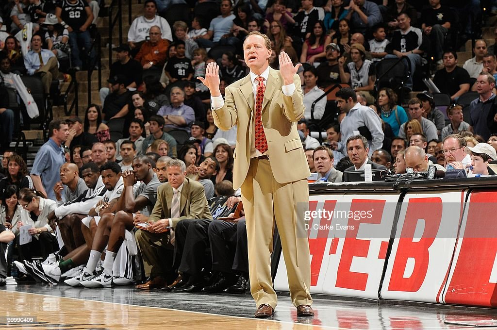 Assistant coach Mike Budenholzer of the San Antonio Spurs gestures from the sideline during the game against the Orlando Magic on April 2, 2010 at the AT&T Center in San Antonio, Texas. The Spurs won 112-100.