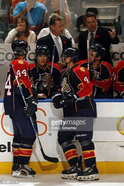 Assistant Coach Mike Kitchen and Jim Hulton of the Florida Panthers direct their team from the bench against the Carolina Hurricanes at the Bank...