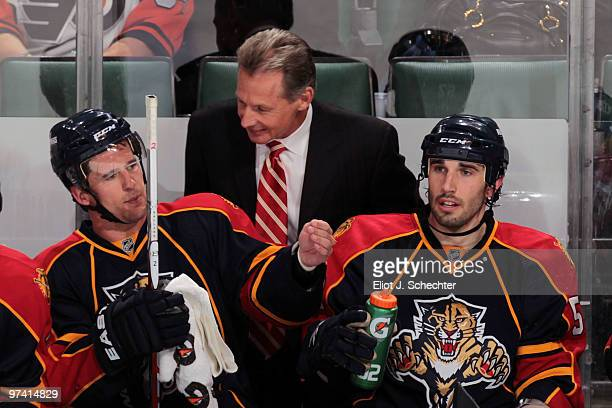 Assistant Coach Mike Kitchen of the Florida Panthers chats with Keith Ballard and teammate Jason Garrison against the Philadelphia Flyers at the...