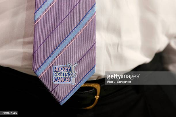Assistant Coach Mike Kitchen of the Florida Panthers wears a purple tie in support of Hockey Fights Cancer Night against the New York Islanders at...