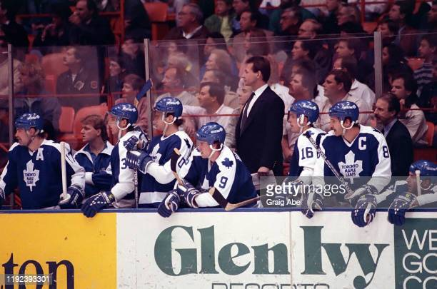 Assistant coach Mike Kitchen of the Toronto Maple Leafs stand behind the bench against the Los Angeles Kings during NHL game action on December 1,...