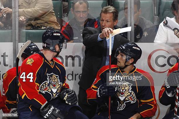 Assistant coach Mike Kitchen talks to Jordan Leopold of the Florida Panthers during a time out against the New York Islanders on November 14, 2009 at...