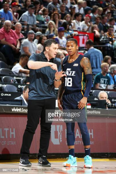 Assistant Coach Mike Wells speaks with Jairus Lyles of the Utah Jazz during the 2018 Summer League at the Vivint Smart Home Arena on July 2 2018 in...