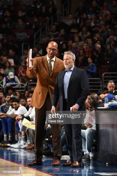 Assistant Coach Monty Williams and Head Coach Brett Brown of the Philadelphia 76ers coach during a game against the Indiana Pacers on December 14...