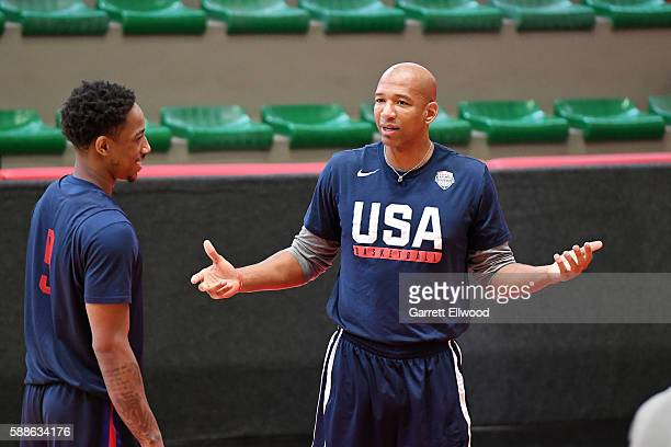 Assistant coach Monty Williams talks to DeMar DeRozan of the USA Basketball Men's National Team at a practice during the Rio 2016 Olympic Games on...