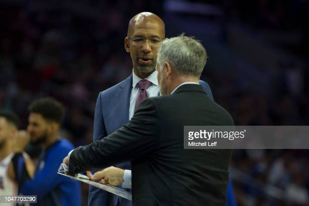 Assistant coach Monty Williams talks to head coach Brett Brown of the Philadelphia 76ers during a timeout against Melbourne United in the preseason...