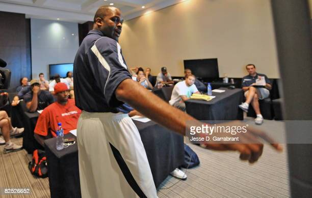 Assistant Coach Nate McMillan of the US Men's Senior National Team goes over plays in practice at the 2008 Beijing Summer Olympics on August 23 2008...