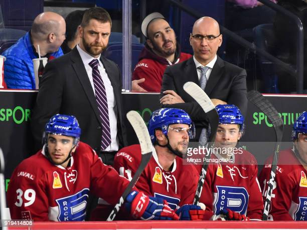 Assistant coach Nick Carriere and head coach of the Laval Rocket Sylvain Lefebvre look on from behind the bench against the Belleville Senators...