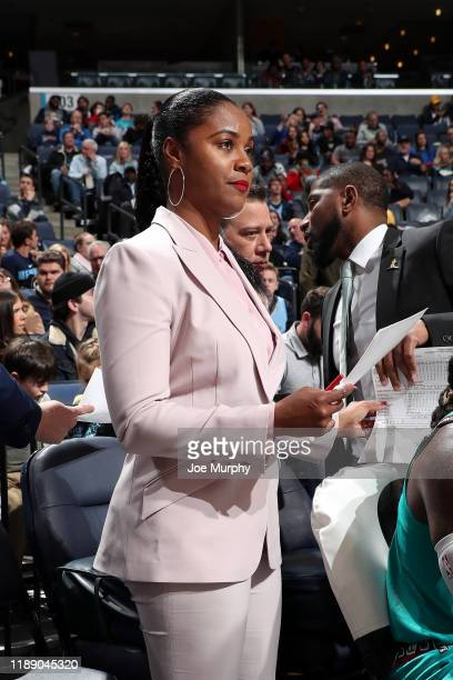 Assistant Coach Niele Ivey of the Memphis Grizzlies looks at paperwork during the game against the Miami Heat on December 16 2019 at FedExForum in...