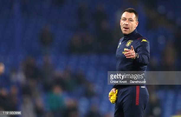 Assistant Coach of Aston Villa John Terry watches his team warm up ahead of the Premier League match between Chelsea FC and Aston Villa at Stamford...