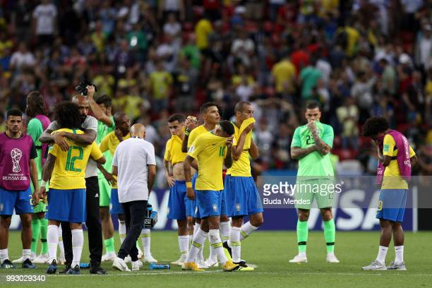 Assistant Coach of Belgium Thierry Henry consoles Marcelo of Brazil during the 2018 FIFA World Cup Russia Quarter Final match between Brazil and...