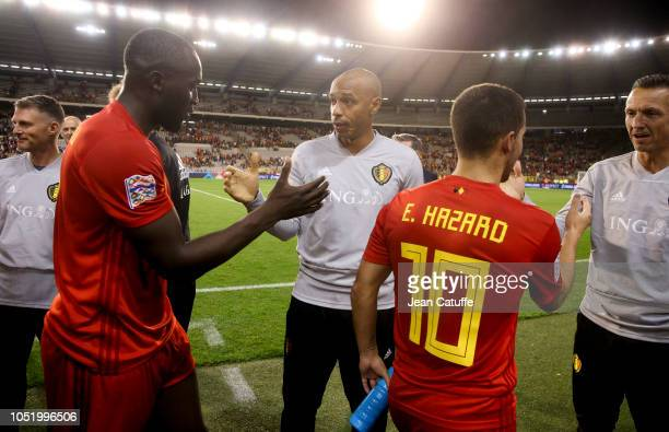 Assistant coach of Belgium Thierry Henry greets Romelu Lukaku and Eden Hazard following the UEFA Nations League A group two match between Belgium and...