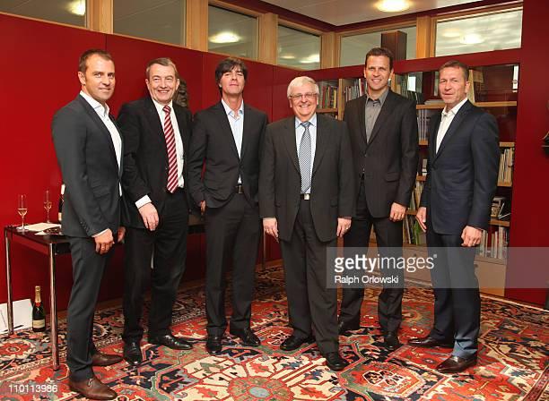 Assistant coach of the German national football team HansDieter Flick general secretary Wolfgang Niersbach team coach Joachim Loew president of the...