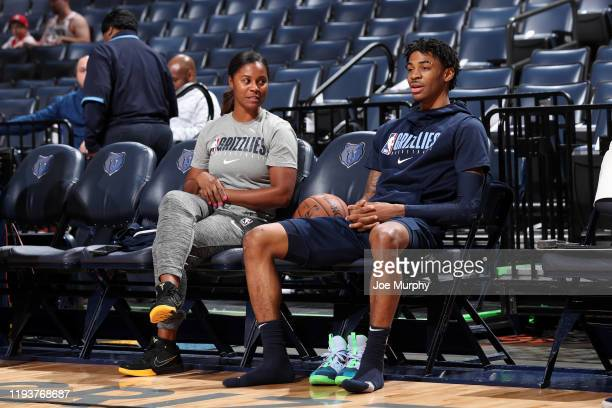 Assistant Coach of the Memphis Grizzlies Niele Ivey shares a conversation with Ja Morant of the Memphis Grizzlies before the game against the Houston...