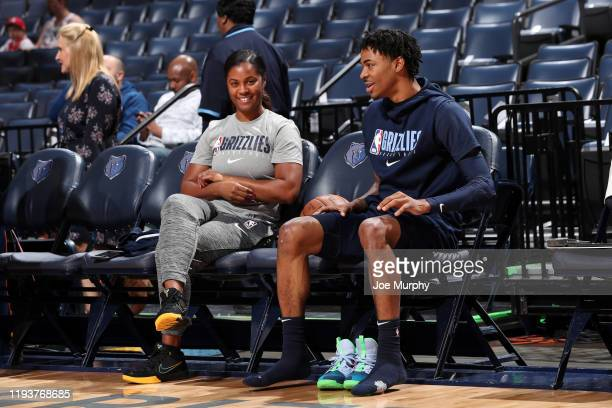 Assistant Coach of the Memphis Grizzlies Niele Ivey sits with Ja Morant of the Memphis Grizzlies before the game against the Houston Rockets on...