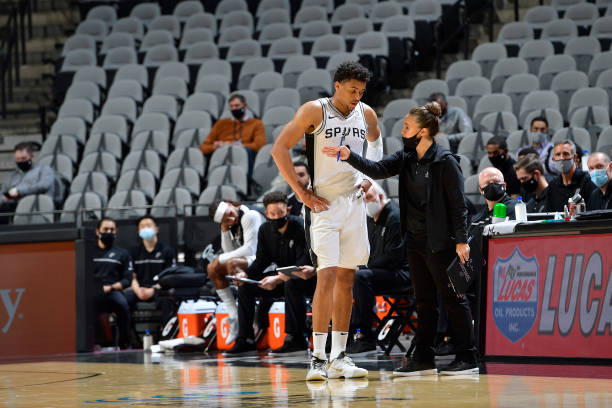 Assistant Coach of the San Antonio Spurs Becky Hammon talks to Keldon Johnson of the San Antonio Spurs during the game against the Utah Jazz on...