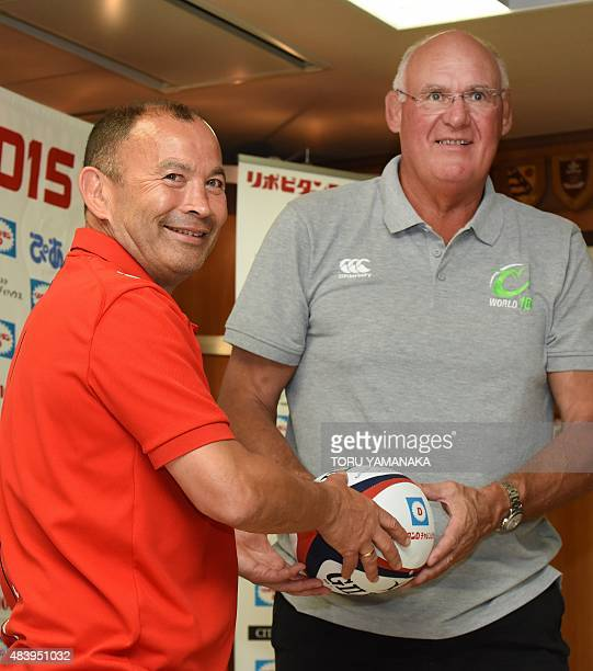 Assistant coach of World XV Andy Haden and head coach of Japanese national team Eddie Jones pose for photographers during their press conference in...