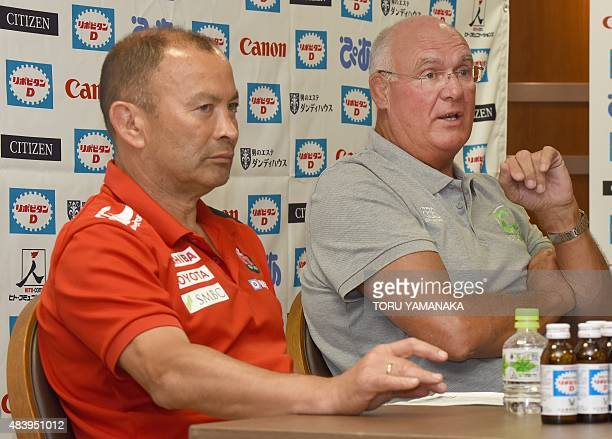Assistant coach of World XV Andy Haden gestures as he answers questions beside head coach of Japanese national team Eddie Jones during their press...