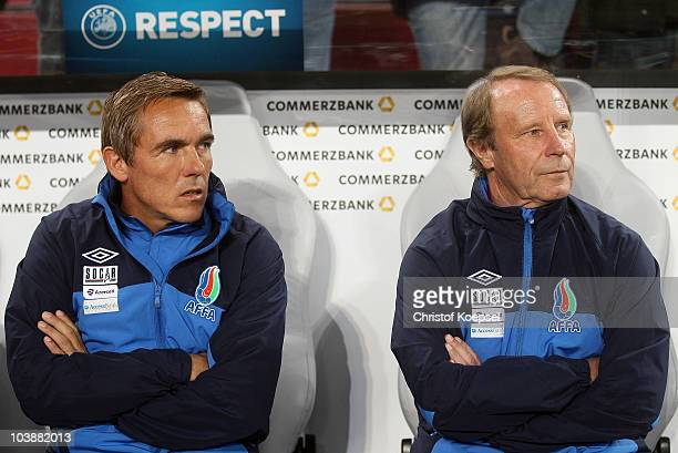 Assistant coach Olaf Janssen and national coach Berti Vogts of Azerbaijan look on during the EURO 2012 Group A Qualifier match between Germany and...