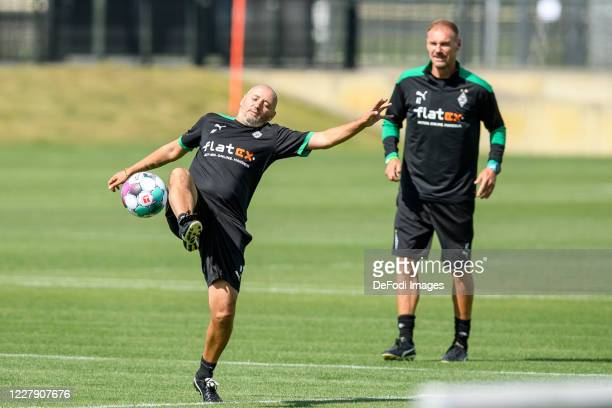 Assistant coach Oliver Neuville of Borussia Moenchengladbach controls the ball during the first training session after the summer break on August 04,...